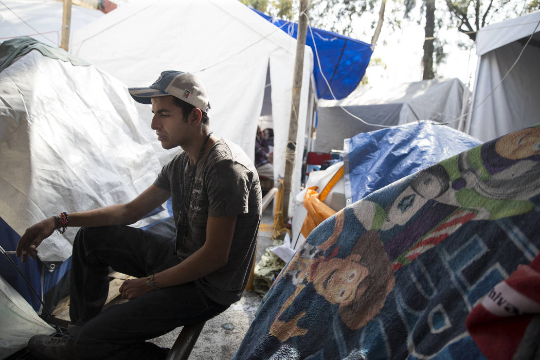 Eduardo Favela Castellanos, who is now homeless living in a tent after his apartment complex, Unidad Habitacional de Tlalpan, suffered structural damage during the Sept. 19 earthquake in Mexico Ci ...