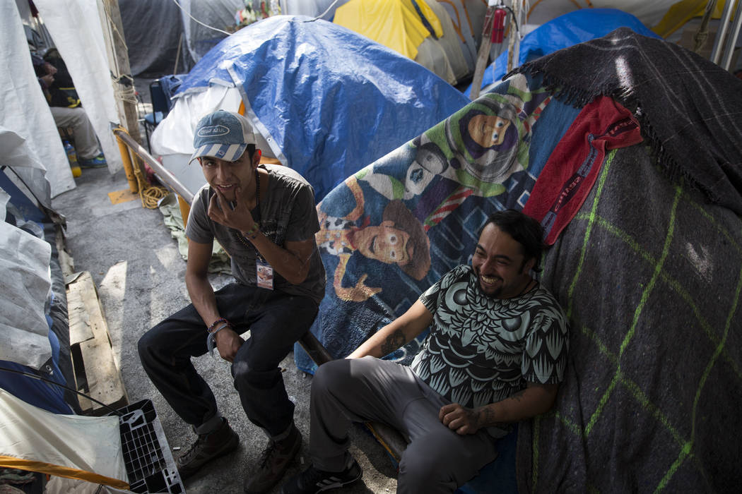 Eduardo Favela Castellanos, left, 25, and Jonathan Rodriguez, 33, who are now homeless living in tents after their apartment complex, Unidad Habitacional de Tlalpan, suffered structural damage dur ...