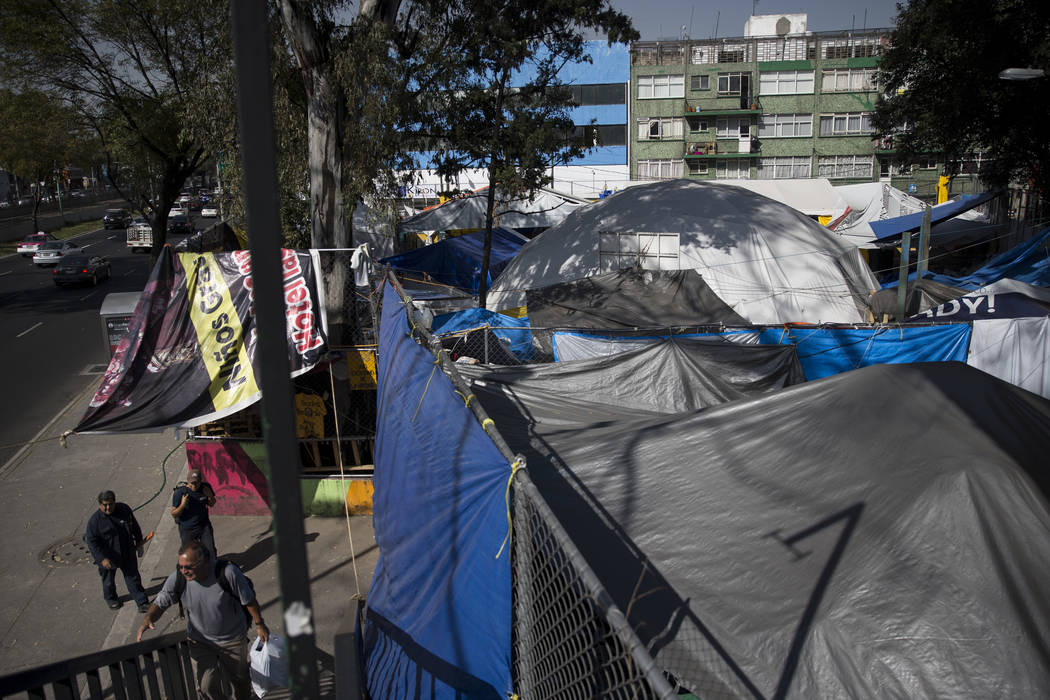 Tents occupied by tenants of the Unidad Habitacional de Tlalpan apartment complex, which suffered structural damage during the Sept. 19 earthquake in Mexico City, Mexico, Friday, Nov. 17, 2017. On ...