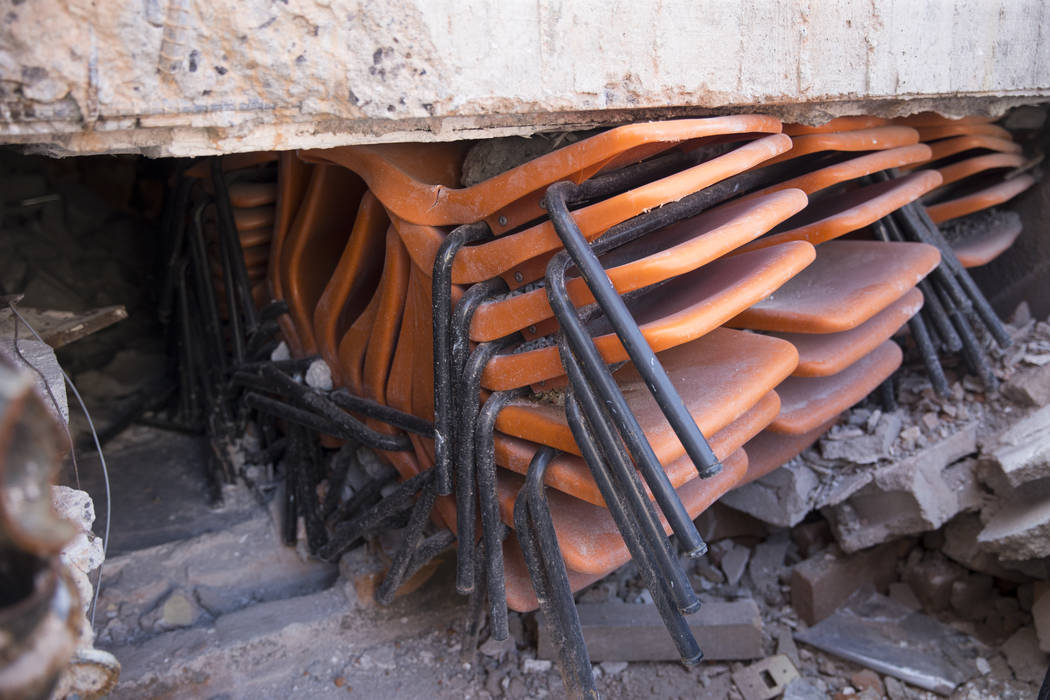 Chairs beneath the collapsed Colegio Enrique Rebsamen elementary school, which was destroyed during the Sept. 19 earthquake in Mexico City, Mexico, Friday, Nov. 17, 2017. Nineteen children died in ...