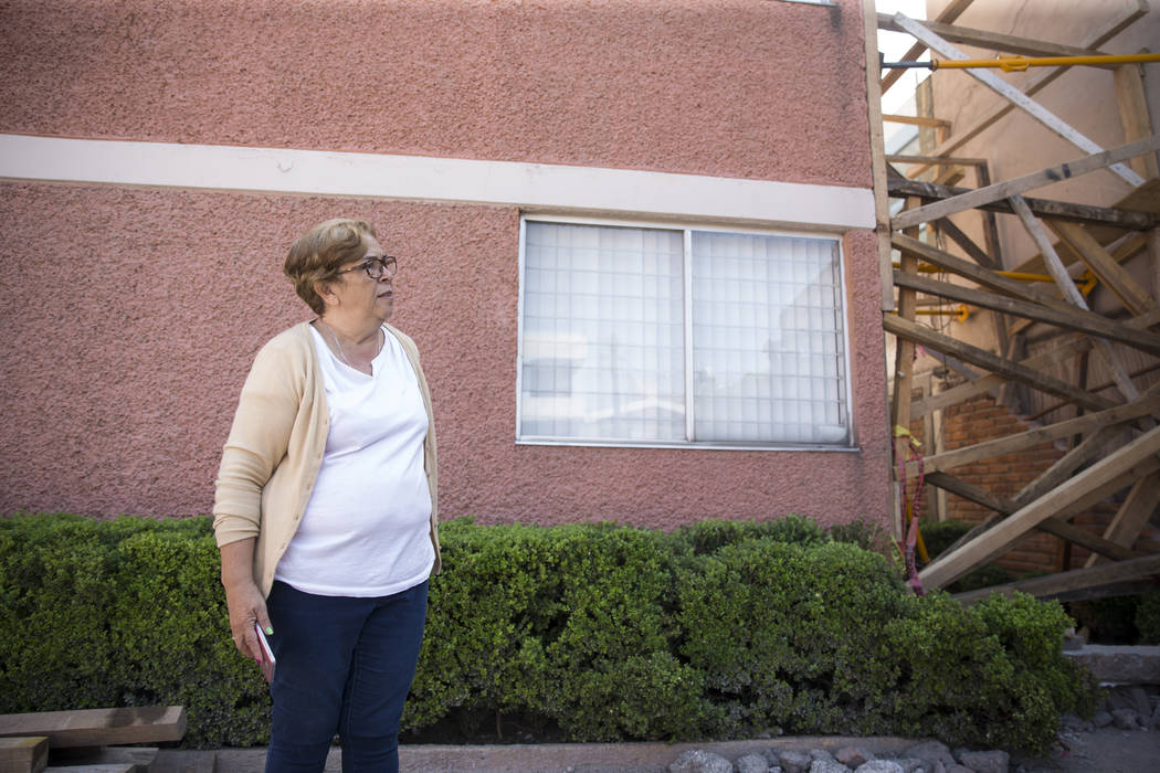 Georgina Godinez Cadena, who lives across adjacent to the Colegio Enrique Rebsamen elementary school, which collapsed during the Sept. 19 earthquake in Mexico City, Mexico, in front of her home, F ...