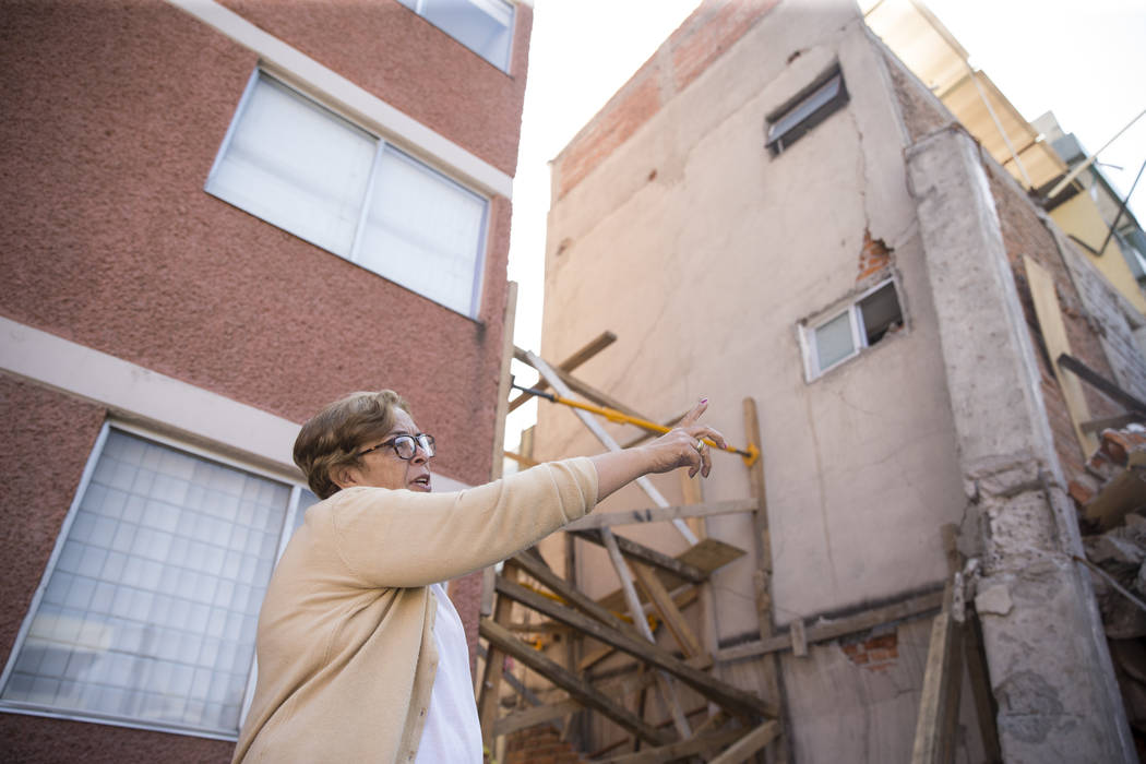 Georgina Godinez Cadena, who lives across adjacent to the Colegio Enrique Rebsamen elementary school, which collapsed during the Sept. 19 earthquake in Mexico City, Mexico, talks about the earthqu ...