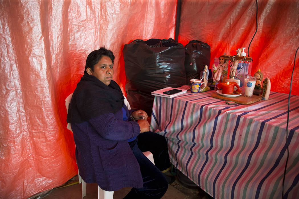 Olga Peralta Rosas, who watches an unhabitale apartment complex adjecent to the Colegio Enrique Rebsamen elementary school, which collapsed during the Sept. 19 earthquake in Mexico City, Mexico, w ...