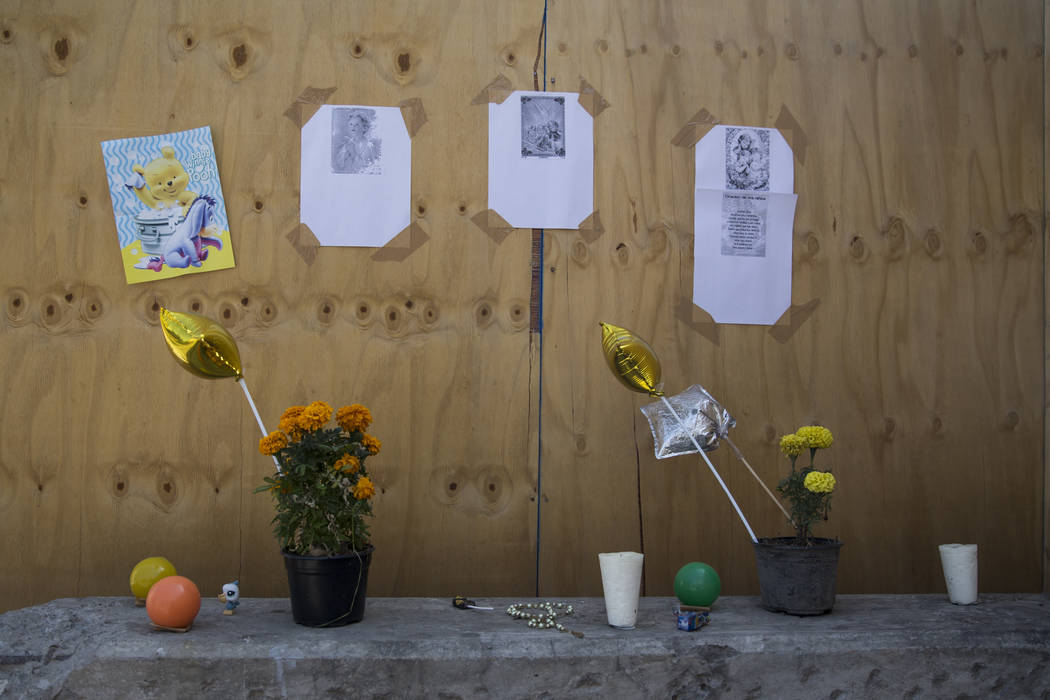 A memorial for the victims who died in the Colegio Enrique Rebsamen elementary school, which collapsed during the Sept. 19 earthquake in Mexico City, Mexico, Friday, Nov. 17, 2017. Nineteen childr ...