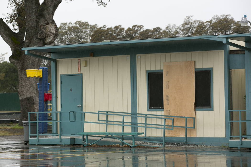 Plywood covers one of the windows at the Rancho Tehama Elementary School, Wednesday, Nov. 15, 2017, that was shot out during gunman Kevin Janson Neal's shooting rampage at Rancho Tehama Reserve, C ...