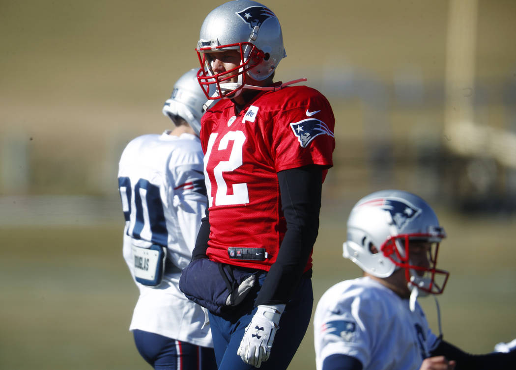 New England Patriots quarterback Tom Brady (12) takes part in drills before practicing Wednesday, Nov. 15, 2017, on the campus of the Air Force Academy in Air Force Academy, Colo. The Patriots are ...
