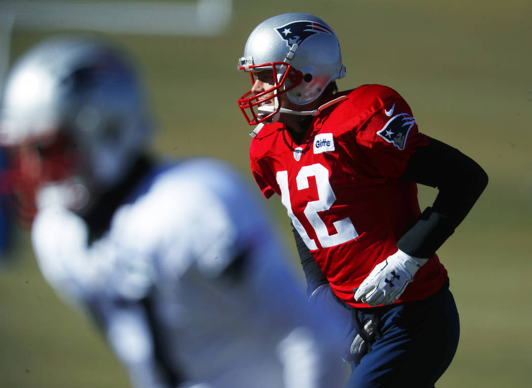 New England Patriots quarterback Tom Brady takes part in drills before practicing Wednesday, Nov. 15, 2017, on the campus of the Air Force Academy in Air Force Academy, Colo. The Patriots are prac ...