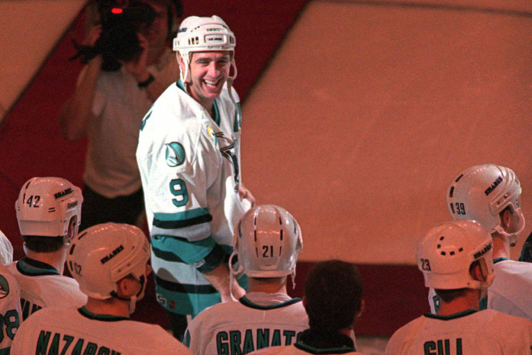 San Jose Sharks center Bernie Nicholls is surrounded by his teammates as they celebrate his 1,000th NHL game, Saturday night, Nov. 2, 1996, during a pre-game ceremony before the Sharks game agains ...