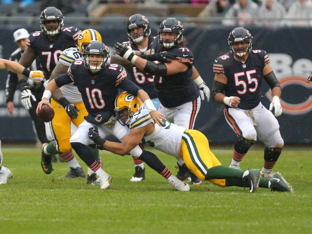 Nov 12, 2017; Chicago, IL, USA; Chicago Bears quarterback Mitchell Trubisky (10) is sacked by Green Bay Packers outside linebacker Nick Perry (53) during the second quarter at Soldier Field. Manda ...