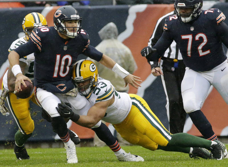 Nov 12, 2017; Chicago, IL, USA;  Chicago Bears quarterback Mitchell Trubisky (10) is sacked by Green Bay Packers outside linebacker Nick Perry (53) during the first quarter  at Soldier Field. Mand ...