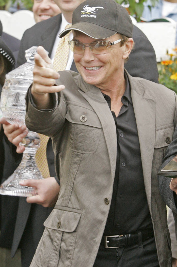 David Cassidy, co-owner and breeder of Black Eyed Susan winner Sweet Vendetta points to photographers in the winners circle at Pimlico Race Course Friday, May 16, 2008 in Baltimore. The 133rd runn ...