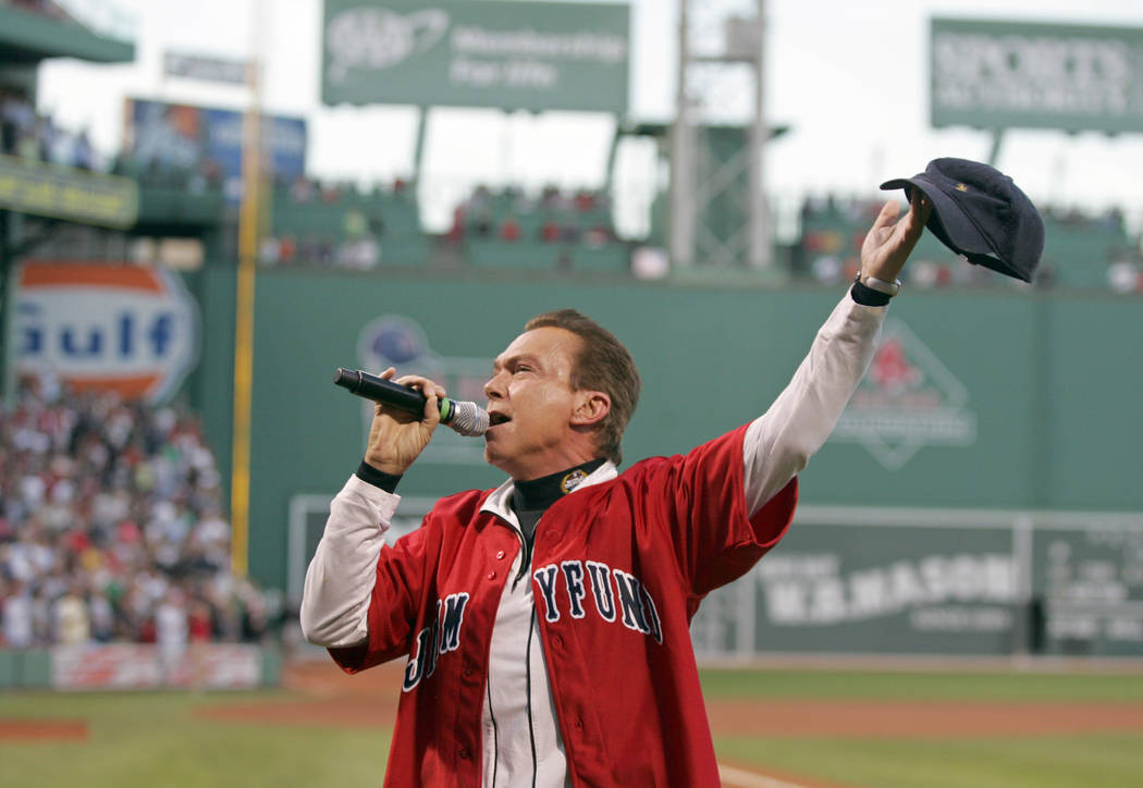 Entertainer David Cassidy sings the National Anthem before the start of a baseball game between the Boston Red Sox and Chicago White Sox at Fenway Park in Boston, Thursday, Aug. 27, 2009.  (AP Pho ...