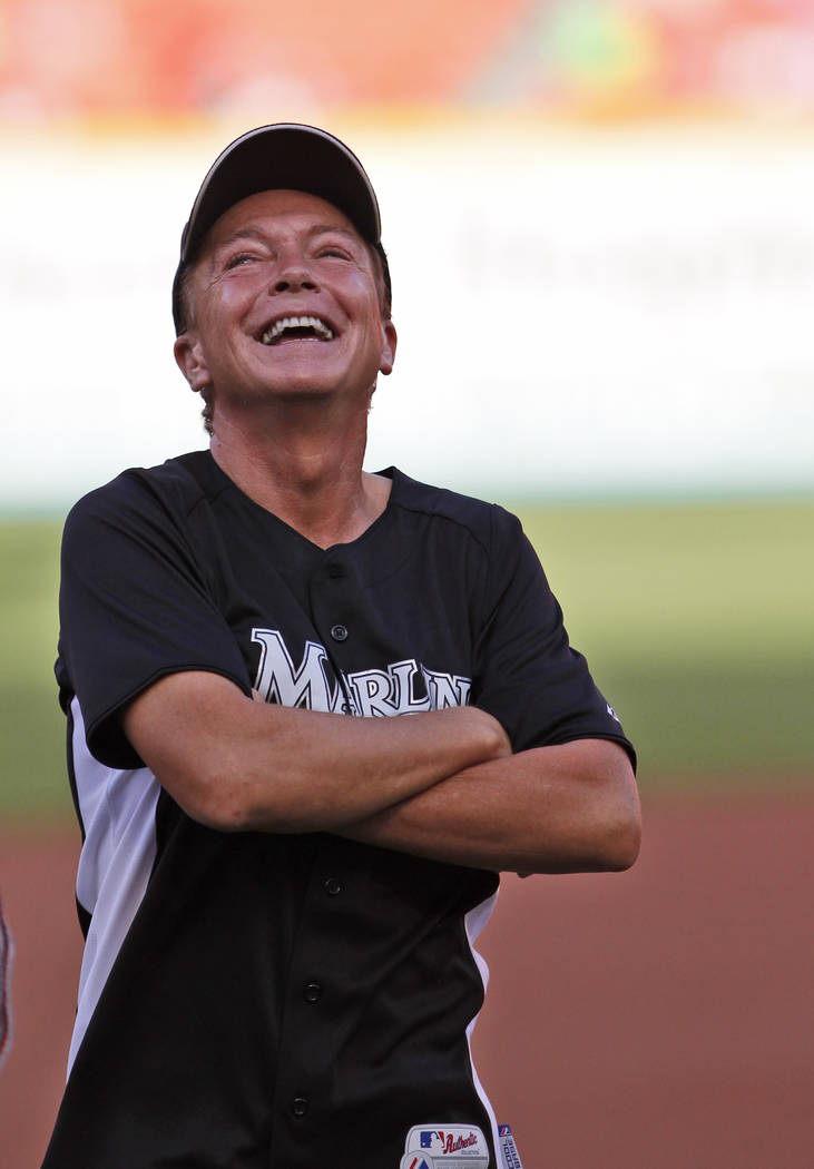 Actor David Cassidy is shown before throwing out a ceremonial first pitch before a baseball game between the Florida Marlins and the Houston Astros, Saturday July 9, 2011 in Miami. (AP Photo/Wilfr ...