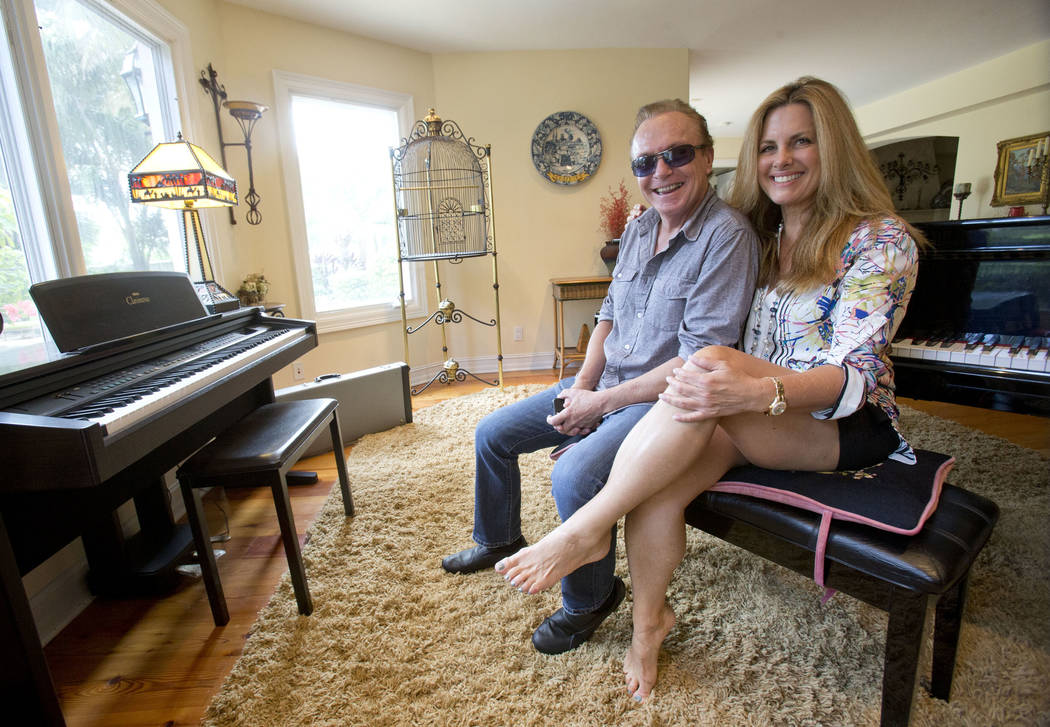 In this, July 22, 2015 file photo, 1970's heartthrob David Cassidy and his girlfriend Maura Rossi pose for a photo in his five-bedroom Florida mansion in Fort Lauderdale, Fla.  (AP Photo/Wilfred ...