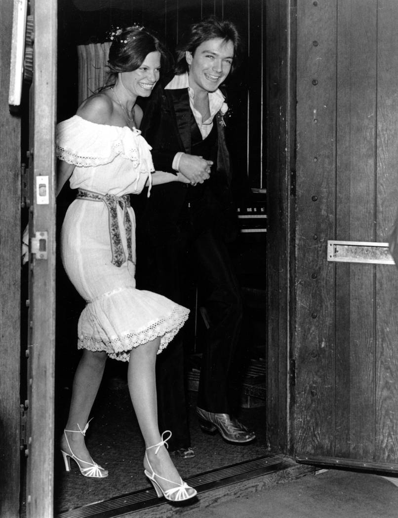 "Pop singer David Cassidy and actress Kay Lenz leave the ""Little Church of the West"" after their wedding in Las Vegas, NV., on April 3, 1977.  The marriage was delayed 15 minutes  ..."
