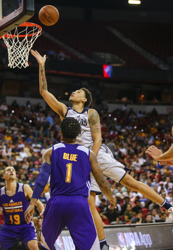 Dallas Mavericks forward Brandon Ashley shoots over Los Angeles Lakers guard Vader Blue (1) and guard Matt Thomas (19) during the NBA Summer League semifinal game at Thomas and Mack Center on Sund ...
