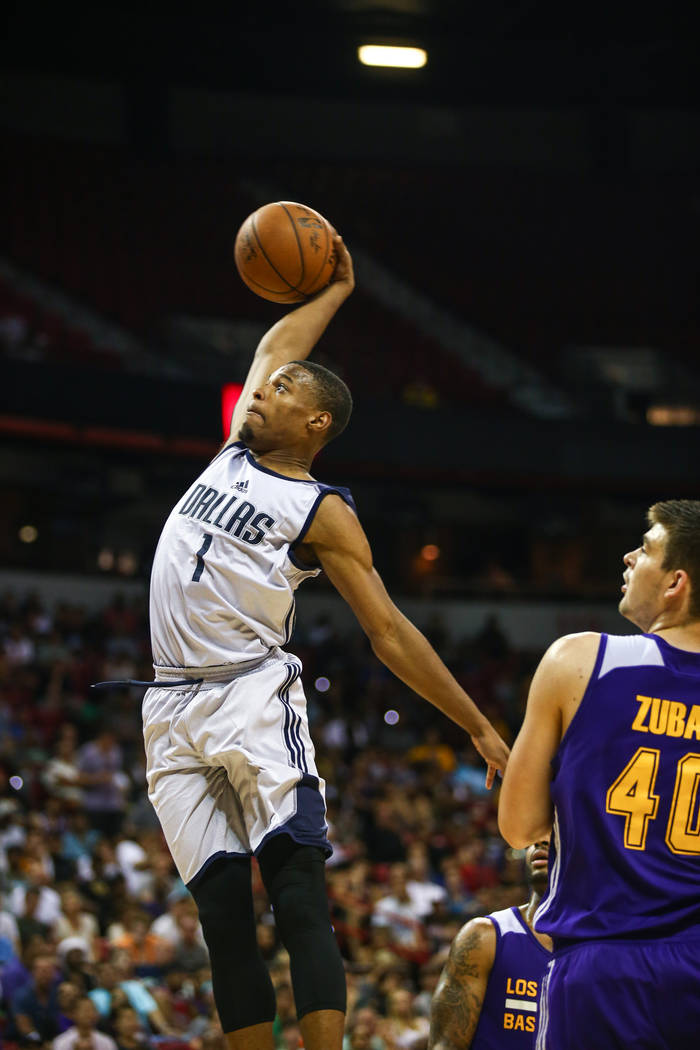 Dallas Mavericks guard Dennis Smith Jr. with a dunk against Los Angeles Lakers center Ivica Zubac during the NBA Summer League semifinal game at Thomas and Mack Center on Sunday, July 16, 2017, in ...
