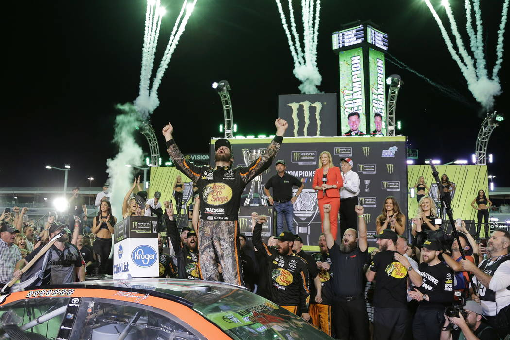 Martin Truex Jr. celebrates in Victory Lane after winning the NASCAR Cup Series auto race and season championship at Homestead-Miami Speedway in Homestead, Fla., Sunday, Nov. 19, 2017. (AP Photo/T ...