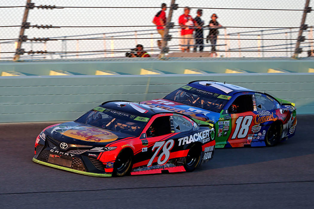 NASCAR Cup Series driver Martin Truex Jr. (78) and NASCAR Cup Series driver Kyle Busch (18) during the Ford EcoBoost 400 at Homestead-Miami Speedway. Mandatory Credit: Peter Casey-USA TODAY Sports