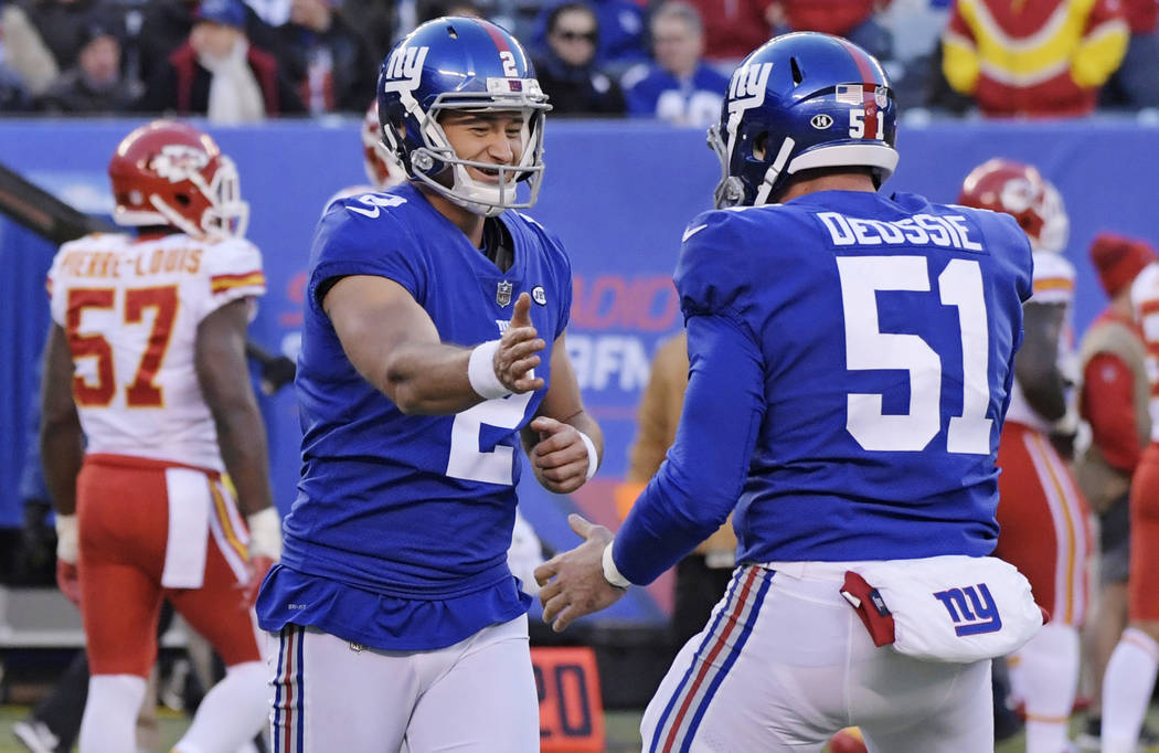 New York Giants kicker Aldrick Rosas (2) celebrates a field goal with teammate Zak DeOssie (51) during the second half of an NFL football game against the Kansas City Chiefs, Sunday, Nov. 19, 2017 ...