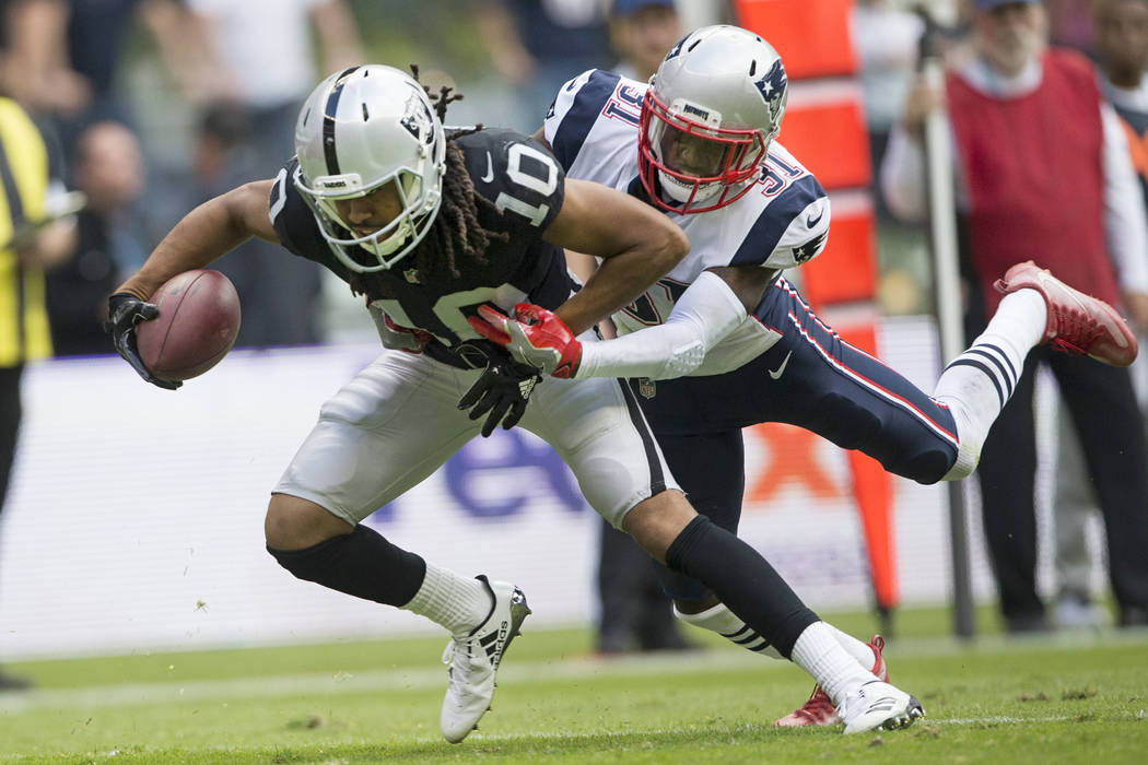Oakland Raiders wide receiver Seth Roberts (10) before fumbling the ball against New England Patriots cornerback Jonathan Jones (31) in the NFL football game at Estadio Azteca in Mexico City, Sund ...