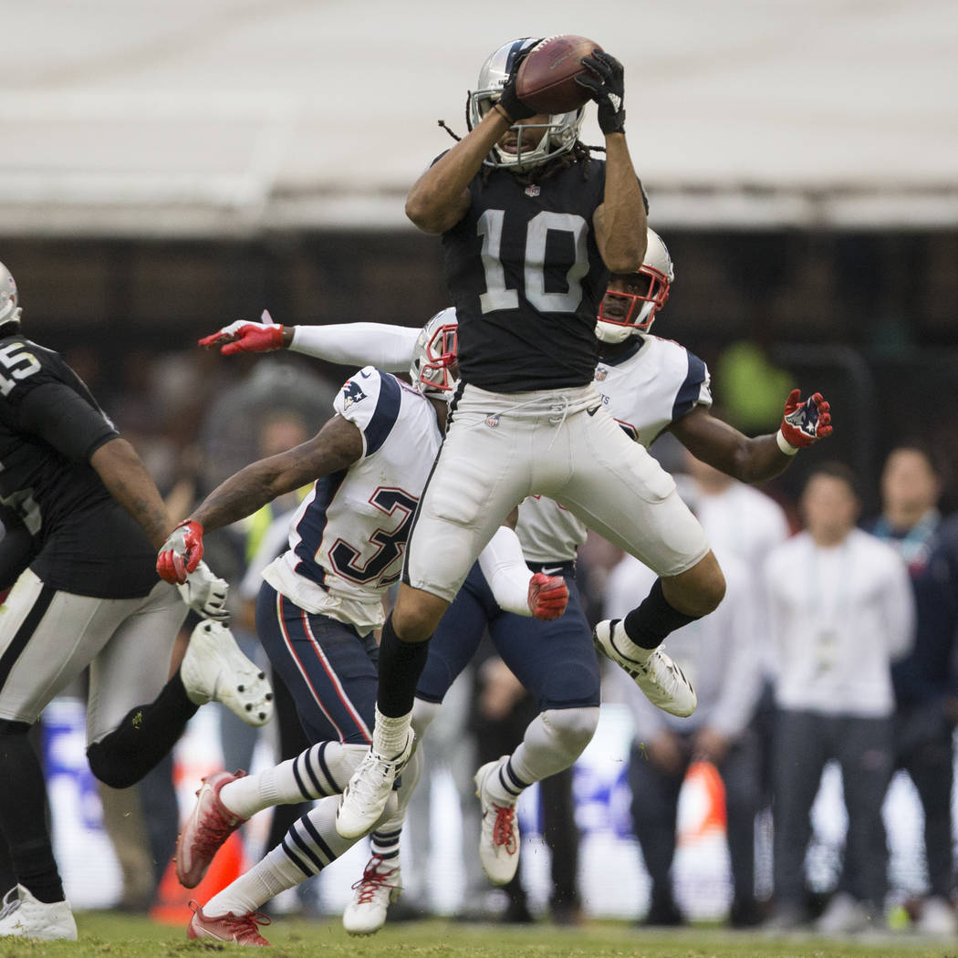 Oakland Raiders wide receiver Seth Roberts (10) makes a catch against the New England Patriots in the NFL football game at Estadio Azteca in Mexico City, Sunday, Nov. 19, 2017. New England Patriot ...