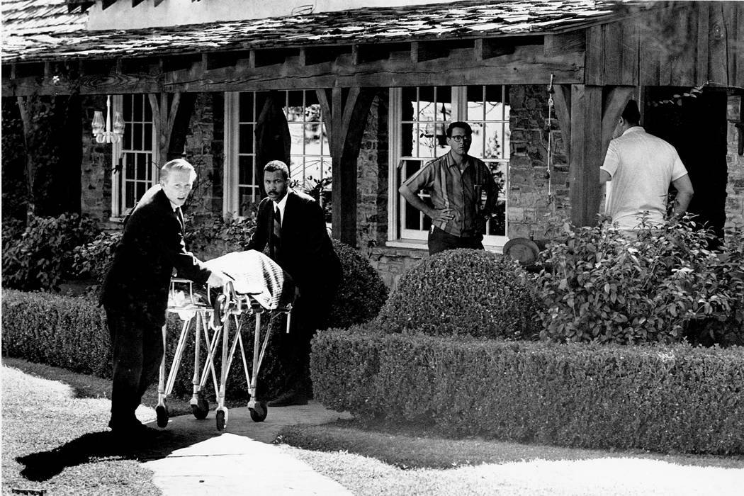 The body of actress Sharon Tate is taken from her rented house on Cielo Drive in Beverly Hills, Calif., on Aug. 9, 1969.  Tate, who was eight months pregnant, and four other persons were found mur ...