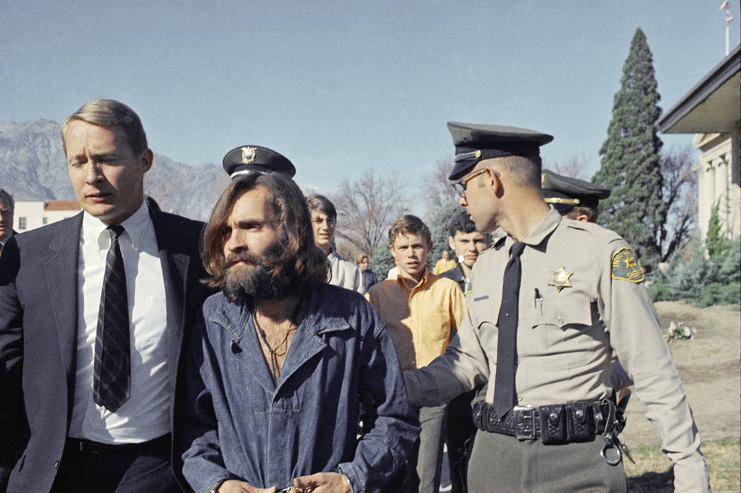 Charles Manson, leader of a hippie cult linked to the Sharon Tate murders, strides from jail to courtroom at Independence, Calif., Dec. 3, 1969, for a preliminary hearing on charges of possessing  ...