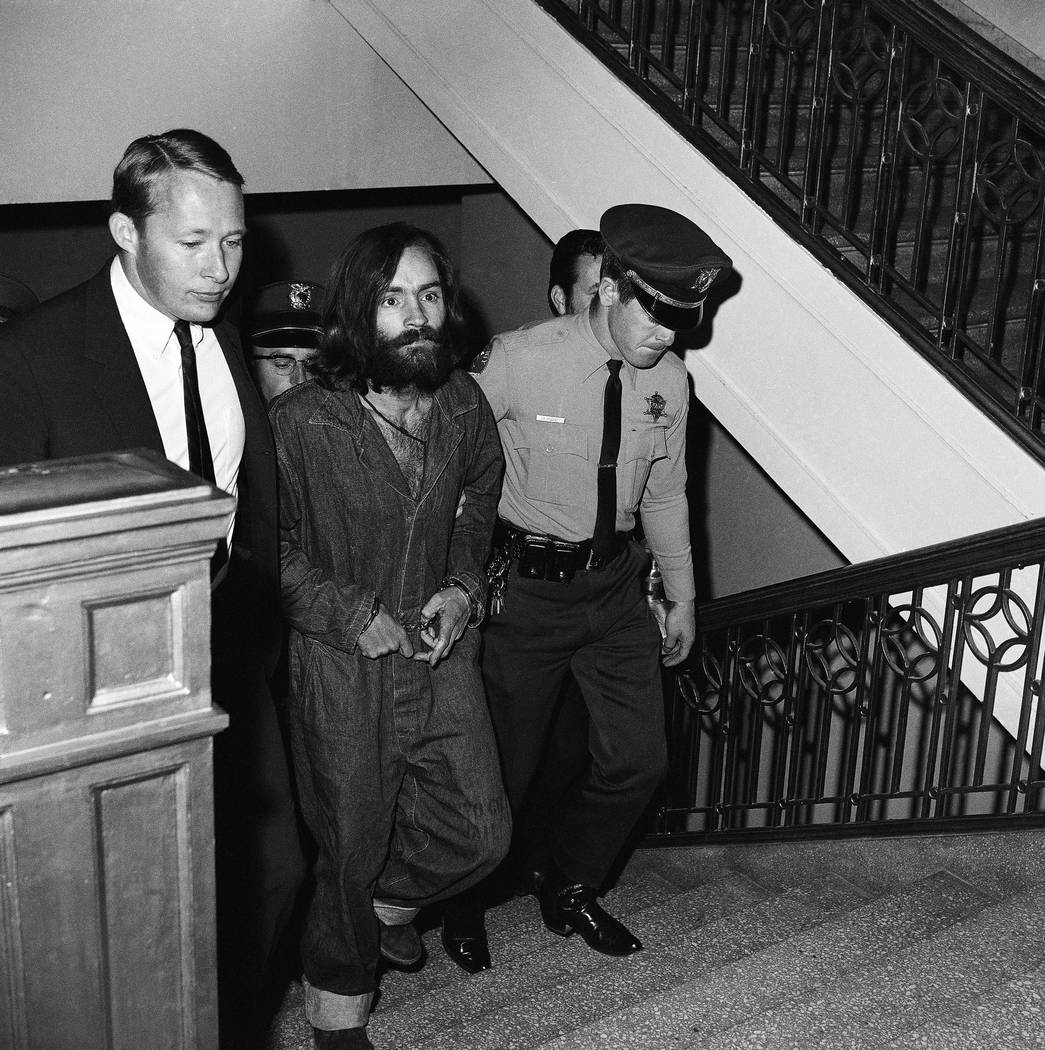 "Charles M. Manson, 35-year-old bearded leader of a communal clan he calls ""the family"" is shown as he arrived in Los Angeles, Dec. 10, 1969, to be jailed on murder-conspiracy cha ..."