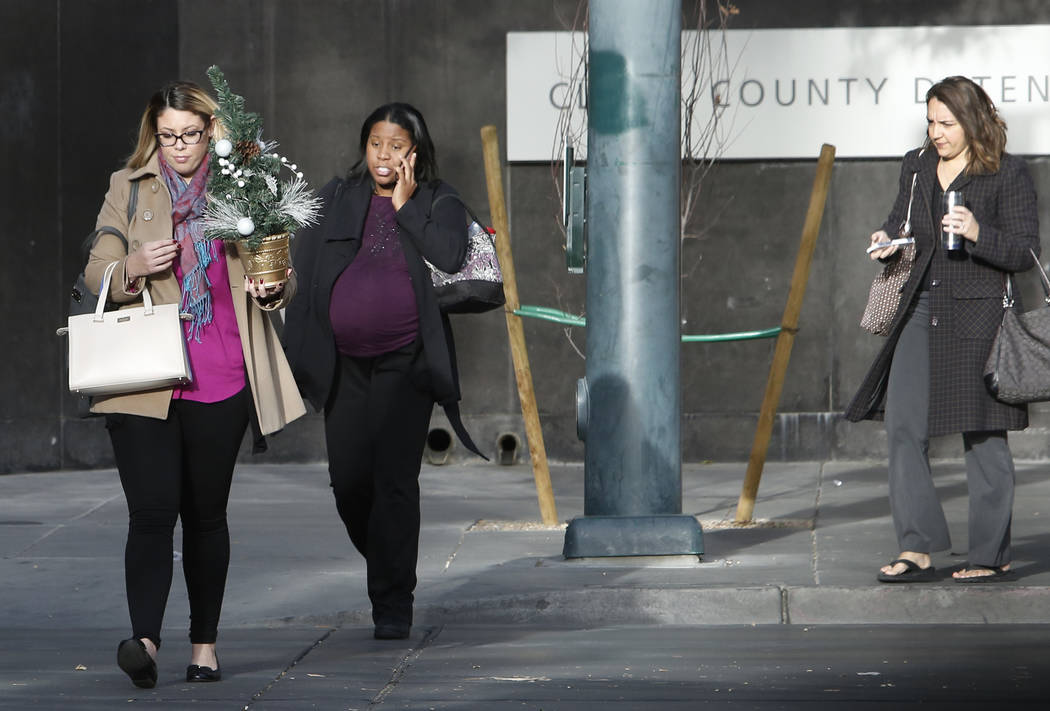Pedestrians, including Gabriella Konicek, left, wearing heavy coats cross Casino Center Boulevard during a cold morning in downtown Las Vegas on Monday, Nov. 20, 2017. Bizuayehu Tesfaye Las Vegas  ...