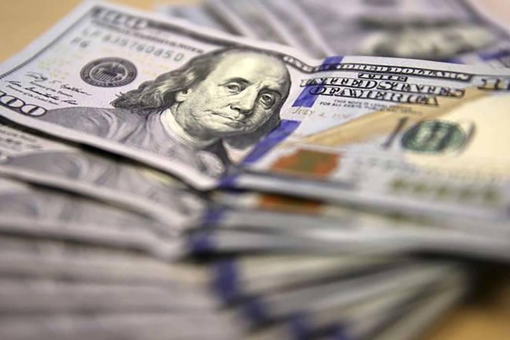 Someone passing counterfeit $100 bills has targeted Las Vegas area garage sales. (Siphiwe Sibeko/Reuters)