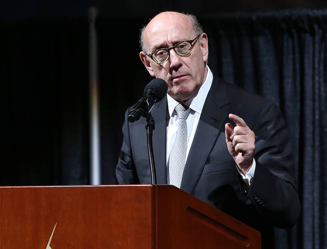 Kenneth Feinberg, administrator of the OneOrlando Fund, answers questions at a town hall meeting at the Amway Center to provide opportunities for the public to ask questions and give feedback on t ...