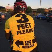 A bike rider, seen Nov. 20, 2017, reminds motorists coming up on him that three feet is the law. (SNBC/Special)