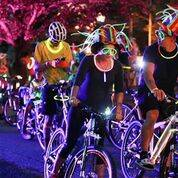 Bike riders glow in the dark, Nov. 20, 2017, as they ride the streets of Las Vegas. The local bicycle coalition is trying to make motorists aware of the Three Feet Law, which required drivers to m ...