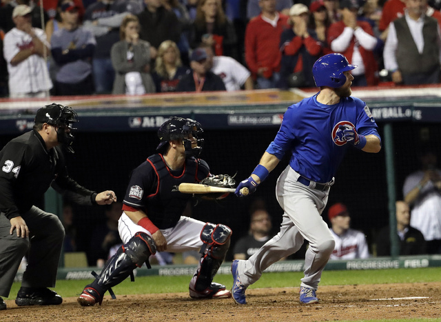 Chicago Cubs' Ben Zobrist hits an RBI double during the 10th inning of Game 7 of the Major League Baseball World Series against the Cleveland Indians Wednesday, Nov. 2, 2016, in Cleveland. (AP Pho ...