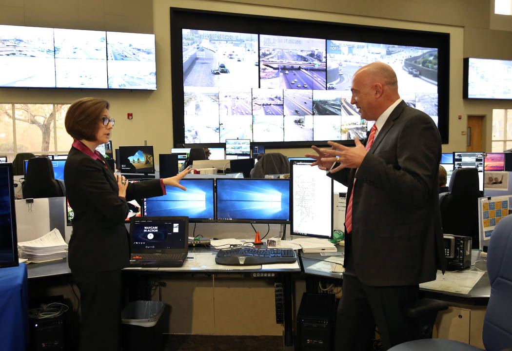 Sen. Catherine Cortez Masto, D-Nev., left, and Brian Hoeft, director of Freeway and Arterial System of Transportation, discuss transportation issue at the FAST traffic management center Tuesday, N ...