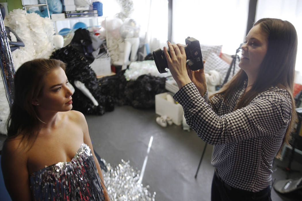 Jennifer Henry photographs Diana Care in a silver fringe dress at her studio at UNLV in Las Vegas, Thursday, Nov. 16, 2017. Rachel Aston Las Vegas Review-Journal @rookie__rae