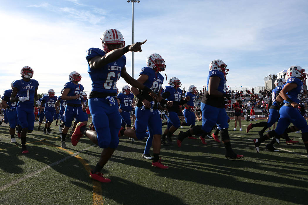 Liberty players take to the field prior to the class 4A state semifinal football game against Bishop Gorman  at Rancho High School in Las Vegas, Friday, Nov. 24, 2017. Bishop Gorman won 35-13. Bri ...