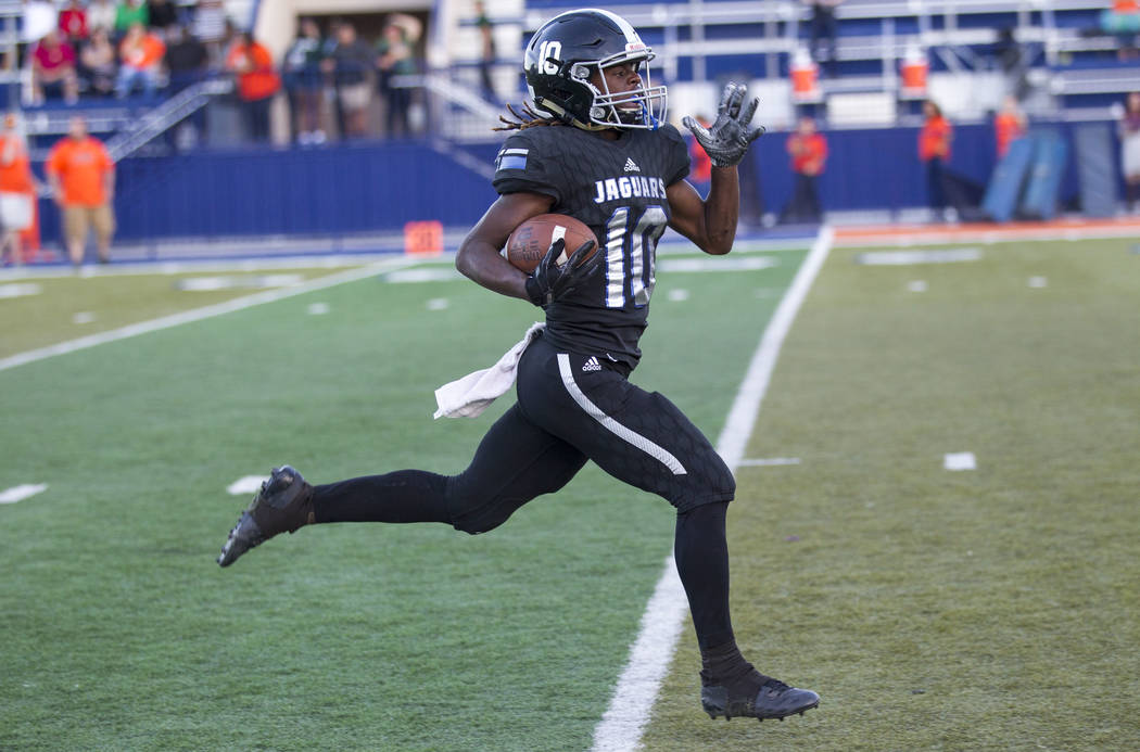 Desert Pines wide receiver Devin McGee (10) breaks away for a touchdown against Mojave in the NIAA Class 3A state championship game at Bishop Gorman High School in Las Vegas on Saturday, Nov. 25,  ...