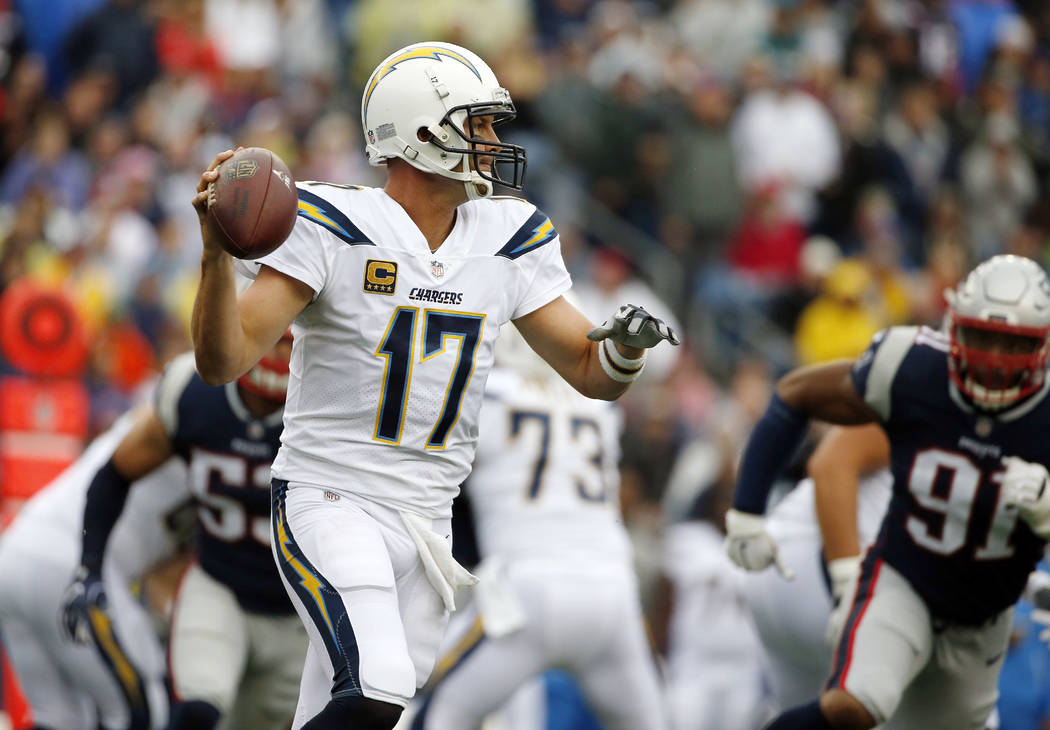 Los Angeles Chargers quarterback Philip Rivers drops back to pass during the first half of an NFL football game against the New England Patriots, Sunday, Oct. 29, 2017, in Foxborough, Mass. (AP Ph ...