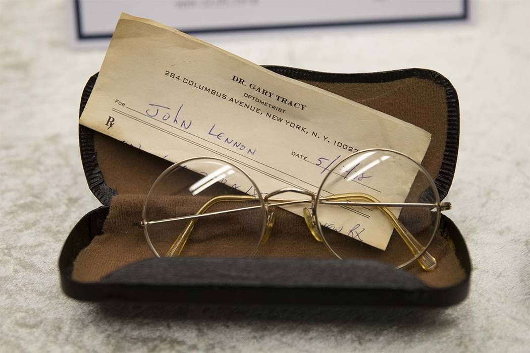 Glasses of John Lennon with a recipe by optometrist Gary Tracy are displayed at the police headquarters in Berlin, Tuesday, Nov. 21, 2017, after German police have arrested a man suspected of hand ...
