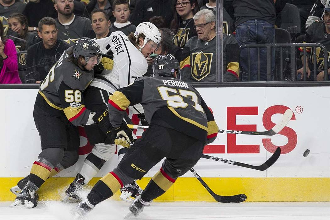 Vegas Golden Knights left wing's Erik Haula (56) and David Perron (57) put pressure on Los Angeles Kings center Tyler Toffoli (73) during the first period of an NHL hockey game at the T-Mobile Are ...