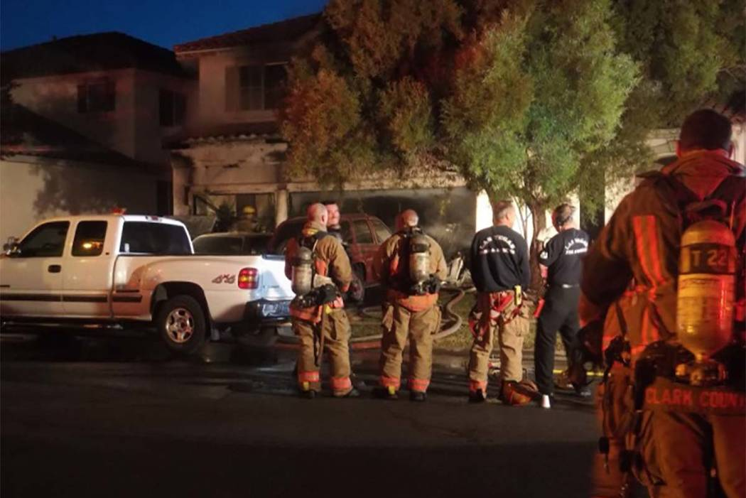 An early morning fire at 3186 Surf Spray St., has left four adults and two children displaced. (Max Michor/Las Vegas Review-Journal)