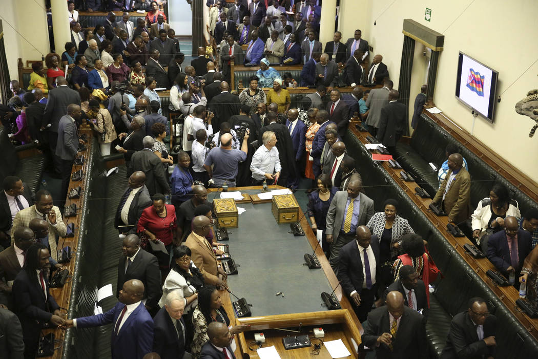 Members of the House of Assembly sit inside the Zimbabwean Parliament in Harare, Zimbabwe, Tuesday, Nov. 21 2017.  Parliament convened as the ruling party seeks to impeach President Robert Mugabe  ...