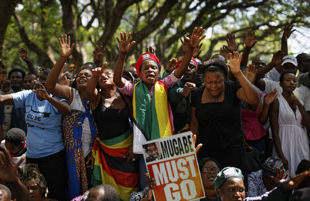 Protesters calling for the impeachment of President Robert Mugabe demonstrate outside the parliament building in Harare, Zimbabwe, Tuesday, Nov. 21, 2017.  (Ben Curtis/AP)
