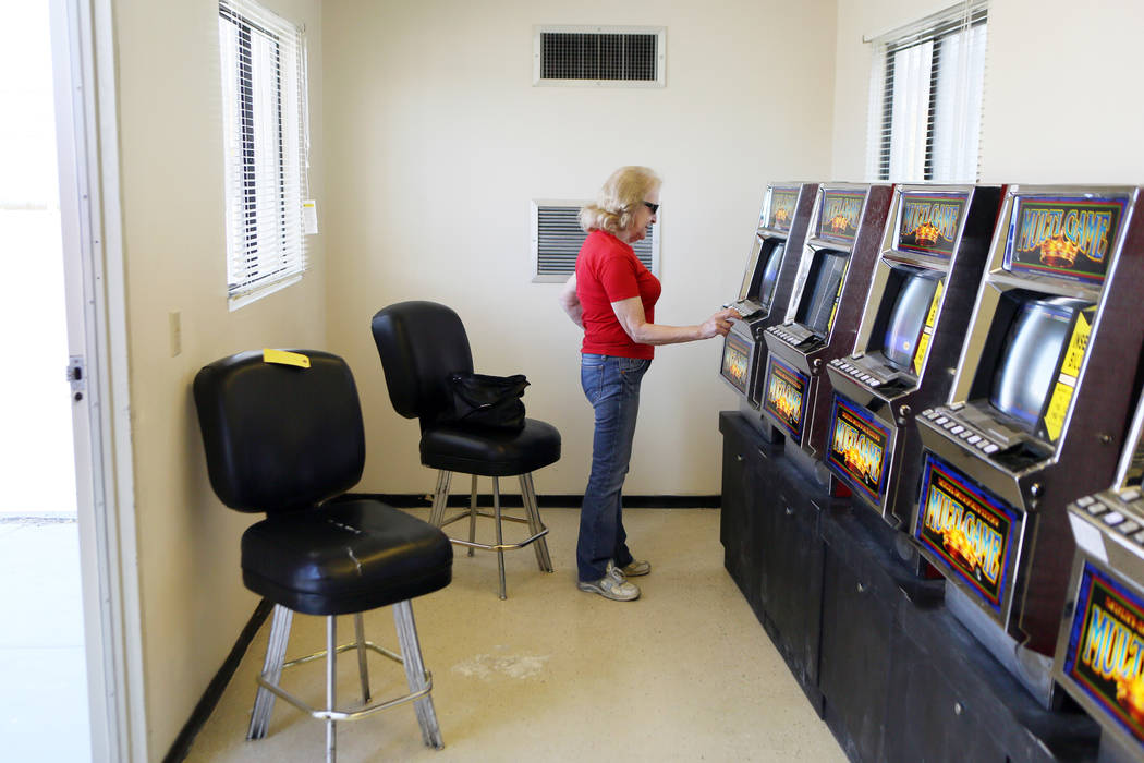 Louise Yokshus plays a slot machine inside a modular building at Moulin Rouge, located at 900 West Bonanza Rd., Wednesday, June 11, 2014, in Las Vegas. Gaming was available temporarily for the pub ...