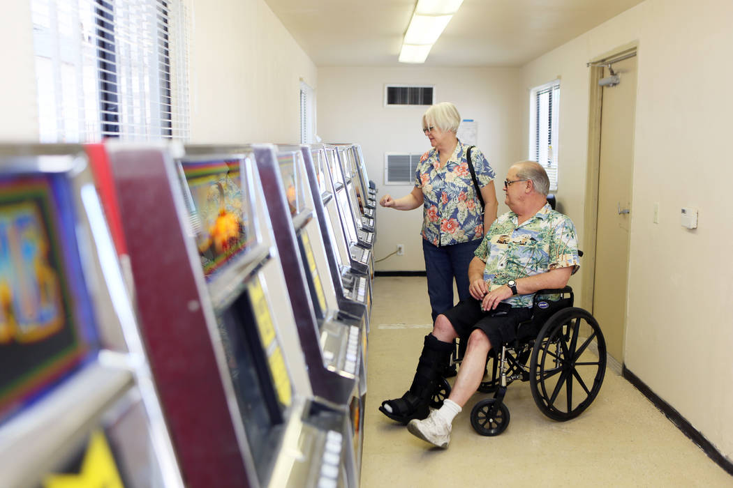 Barbara Moore and her husband Ron play a slot machine inside a modular building at Moulin Rouge, located at 900 West Bonanza Rd., Wednesday, June 11, 2014, in Las Vegas. Gaming was available tempo ...