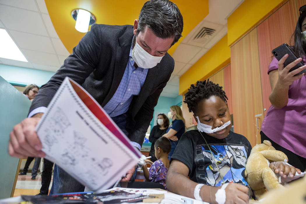 NASCAR champion Martin Truex, Jr. visits a patient at Sunrise Children's Hospital in Las Vegas, Tuesday, Nov. 28, 2017. Elizabeth Brumley Las Vegas Review-Journal @EliPagePhoto