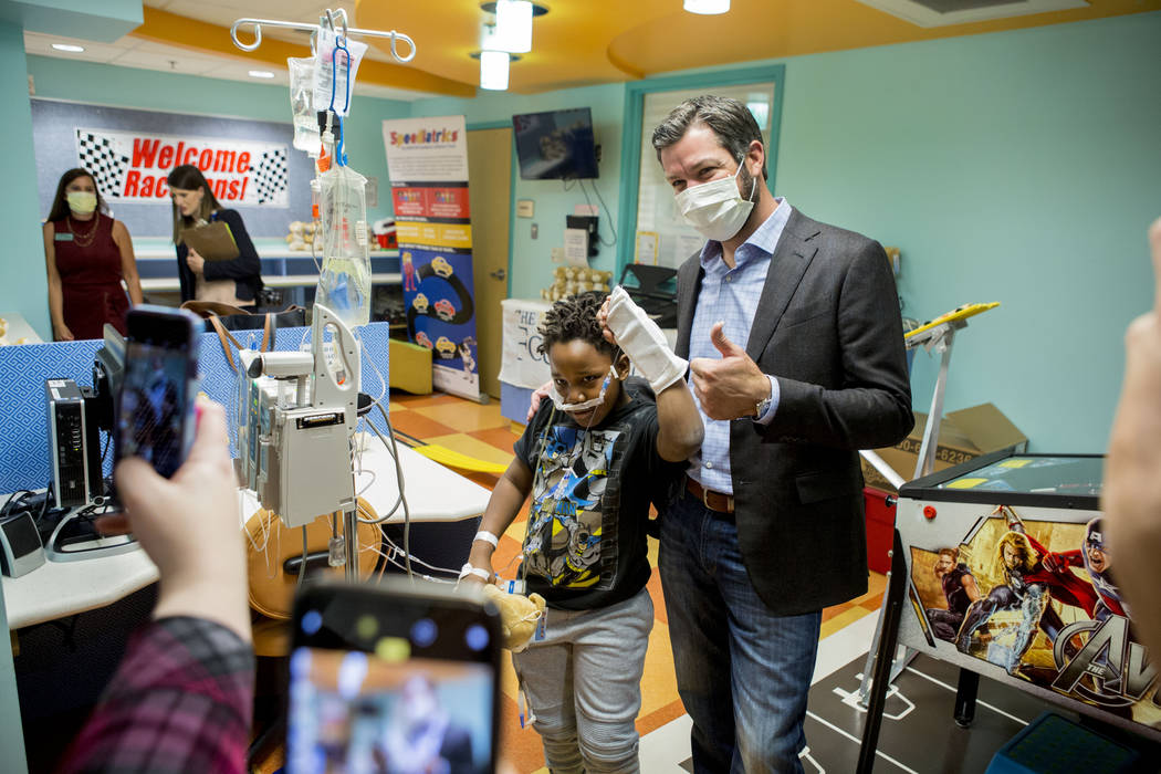 NASCAR champion Martin Truex, Jr. takes a photograph with a patient at Sunrise Children's Hospital in Las Vegas, Tuesday, Nov. 28, 2017. Elizabeth Brumley Las Vegas Review-Journal @EliPagePhoto