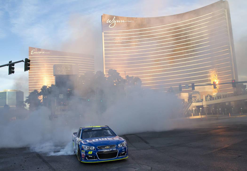 Race car driver Jimmie Johnson (48) burns out on the Vegas Strip during Nascarճ Victory Lap on Wednesday, Nov. 29, 2017.  Richard Brian Las Vegas Review-Journal @vegasphotograph
